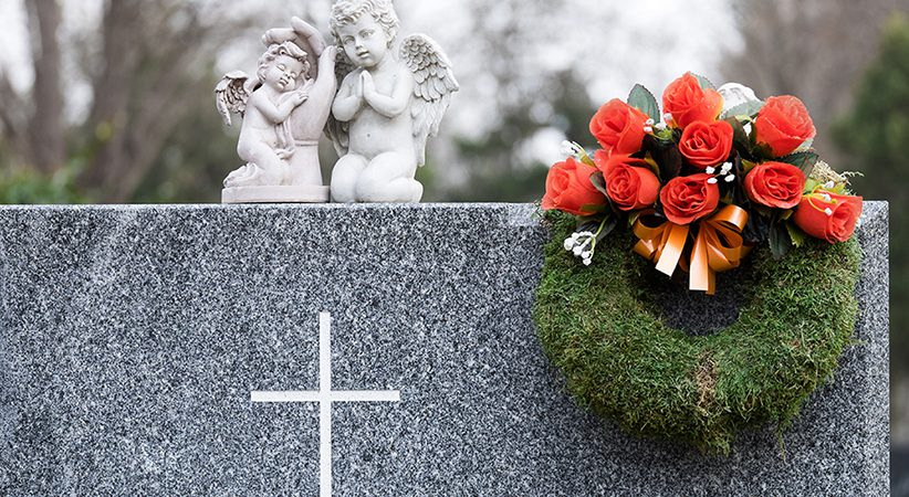 tombstone with angels